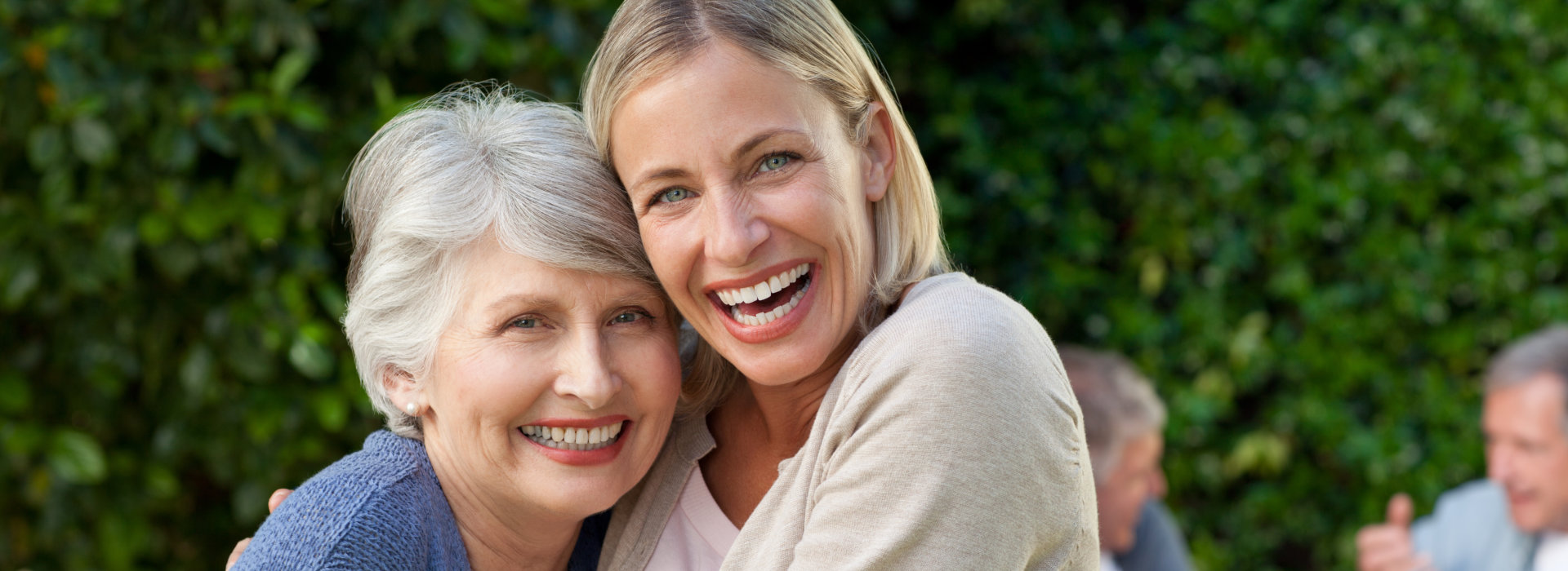 caregiver and elder laughing